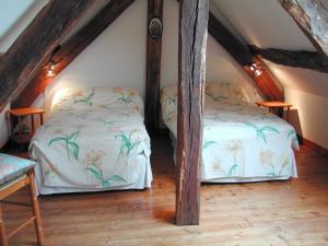 Un ou plusieurs lits dans un hébergement de l'établissement Holiday home La Haute Bignetière