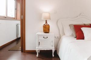 A bed or beds in a room at Casa da villa by TascadoDino