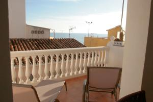 A balcony or terrace at House on the beach with free WIFI and bikes LaCala