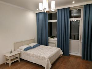 A bed or beds in a room at Comfortable Apartment in the Center