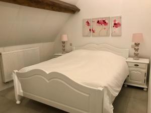 Een bed of bedden in een kamer bij Cense de Lalouette