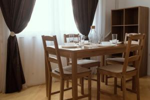 A restaurant or other place to eat at Trio Finest Skopje Apartments