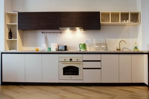 A kitchen or kitchenette at Trio Finest Skopje Apartments