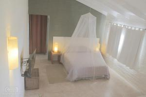 A bed or beds in a room at La Serena Suites Apart