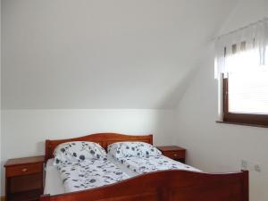 Postelja oz. postelje v sobi nastanitve Two-Bedroom Apartment in Zrece