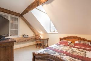 Un ou plusieurs lits dans un hébergement de l'établissement L'Hirondelle