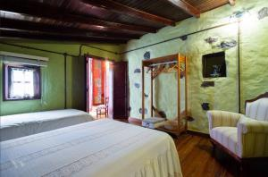 A bed or beds in a room at La Cuadra