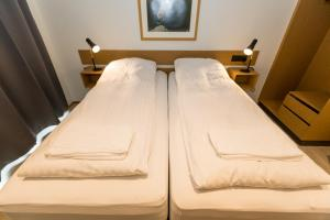 A bed or beds in a room at Hrimland Apartments