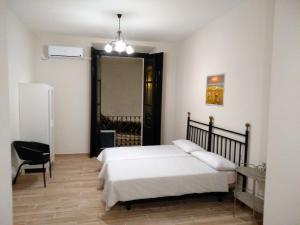 A bed or beds in a room at Apartamento en el centro