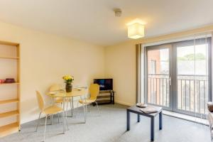 A seating area at 1BR apartment in a beautiful building, walking distance from the Curve Theatre!