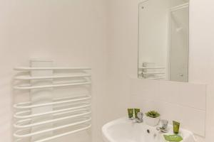 A bathroom at 1BR apartment in a beautiful building, walking distance from the Curve Theatre!