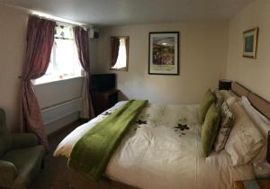 A bed or beds in a room at The Garden Lodge