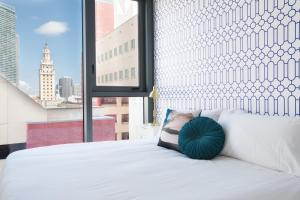 A bed or beds in a room at Guild Miami - Downtown