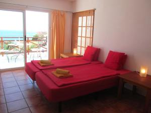 A bed or beds in a room at Casa Policarpo