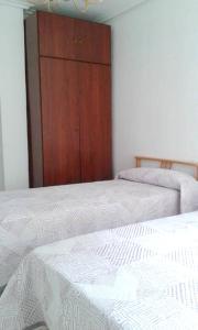 A bed or beds in a room at Apartment Av. Pérez Galdós