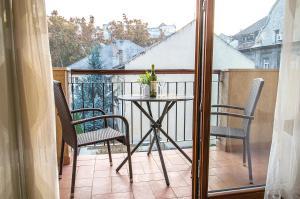 A balcony or terrace at Toscana Apartment