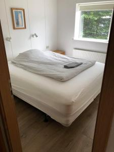 A bed or beds in a room at Akureyri Downtown Apartments Holtagata