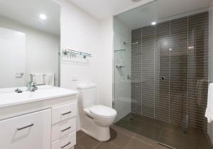 A bathroom at Chifley Apartments Newcastle