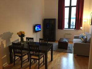 A television and/or entertainment center at Stylish City Centre Apartment