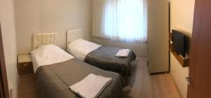 A bed or beds in a room at A Plus