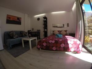 Posteľ alebo postele v izbe v ubytovaní Enjoy Playa las Canteras