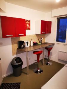 Cuisine ou kitchenette dans l'établissement Appartement Spacieux