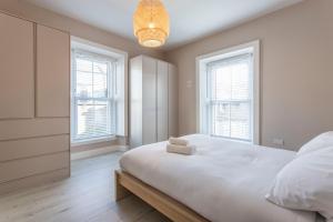 Postel nebo postele na pokoji v ubytování St Michaels Apartments