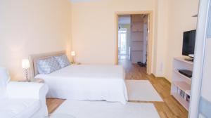 A bed or beds in a room at iRent.by