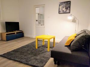 Coin salon dans l'établissement Charmant T2 de 47 m2 en centre-ville