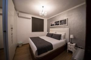 A bed or beds in a room at Apartamento acogedor