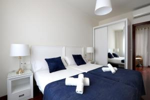 A bed or beds in a room at Classbedroom Apartments IV