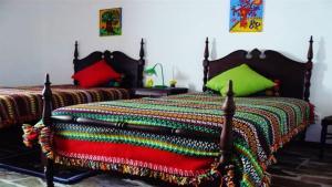 A bed or beds in a room at Casa da Tia Luísa