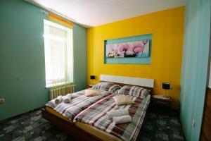 Postelja oz. postelje v sobi nastanitve Apartments Pri Adamsovih