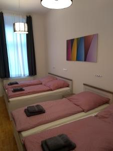 A bed or beds in a room at City-Apartment Zille