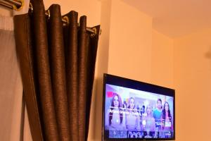 A television and/or entertainment center at Tildah Studio Apartments