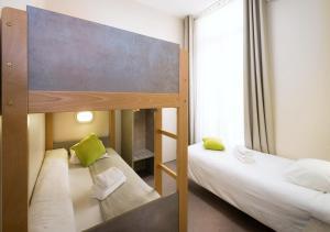 Un ou plusieurs lits dans un hébergement de l'établissement Residence La Canebiere