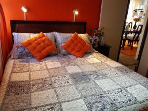 A bed or beds in a room at 47 mil Casa por dia