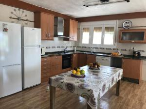 A kitchen or kitchenette at PARADISE EBRO EXPERIENCE