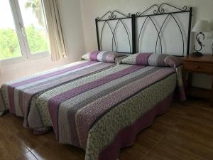 A bed or beds in a room at PARADISE EBRO EXPERIENCE