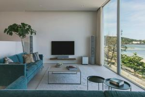 A television and/or entertainment center at Beach House Purau