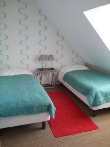 Un ou plusieurs lits dans un hébergement de l'établissement Gîte Les Sables Verts