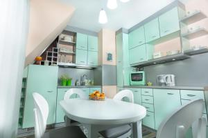 A kitchen or kitchenette at Stylish Apartment Plovdiv II