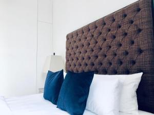 Letto o letti in una camera di Palace Court Apartments