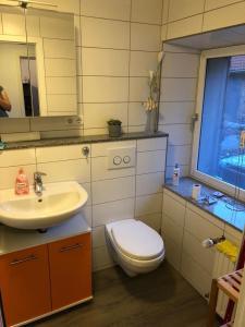 A bathroom at Moderne, große Ferienwohnung