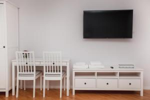 Телевізор і / або розважальний центр в Korali Apartment