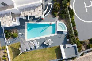 A view of the pool at Santorini Princess Presidential Suites or nearby