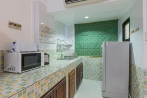A kitchen or kitchenette at Patong Studio Apartments and Dormitory