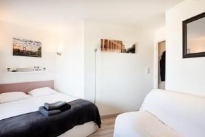 Un ou plusieurs lits dans un hébergement de l'établissement Beau Studio