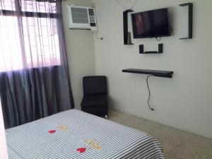 A television and/or entertainment center at Riveri Salinas 9