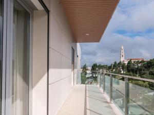 A balcony or terrace at Luz de Fátima - Alojamentos